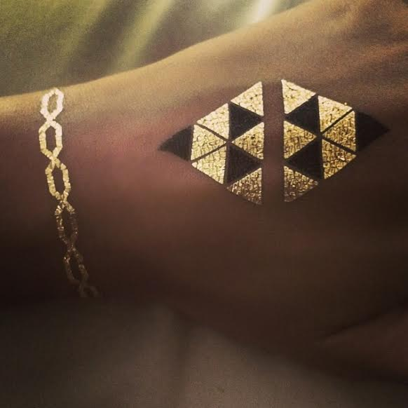 photo credit: beyonce Queen B and her Flash Tattoo